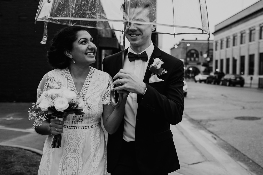 Bride and groom in Downtown Rochester, Michigan. Photographed by Nicole Leanne Photography.
