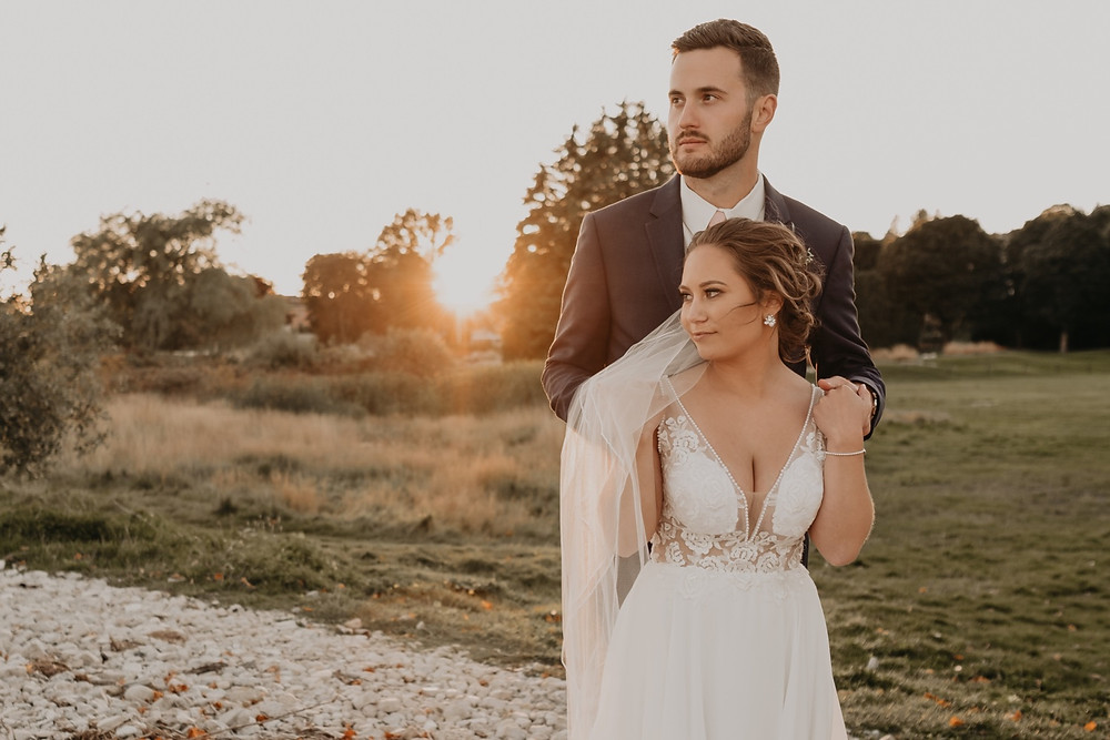 Sunset wedding photos with bride and groom at Mission Point Resort. Photographed by Nicole Leanne Photography.
