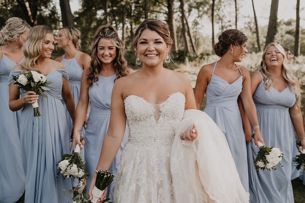 Bride with bridesmaids after wedding ceremony. Photographed by Nicole Leanne Photography.