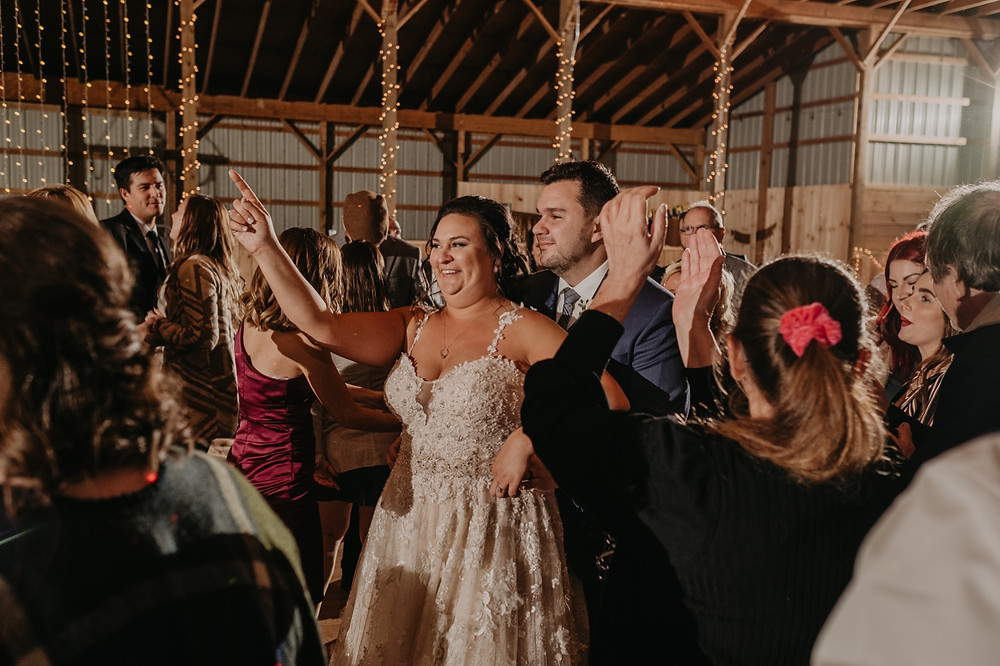 Metro Detroit couple dancing with wedding guests