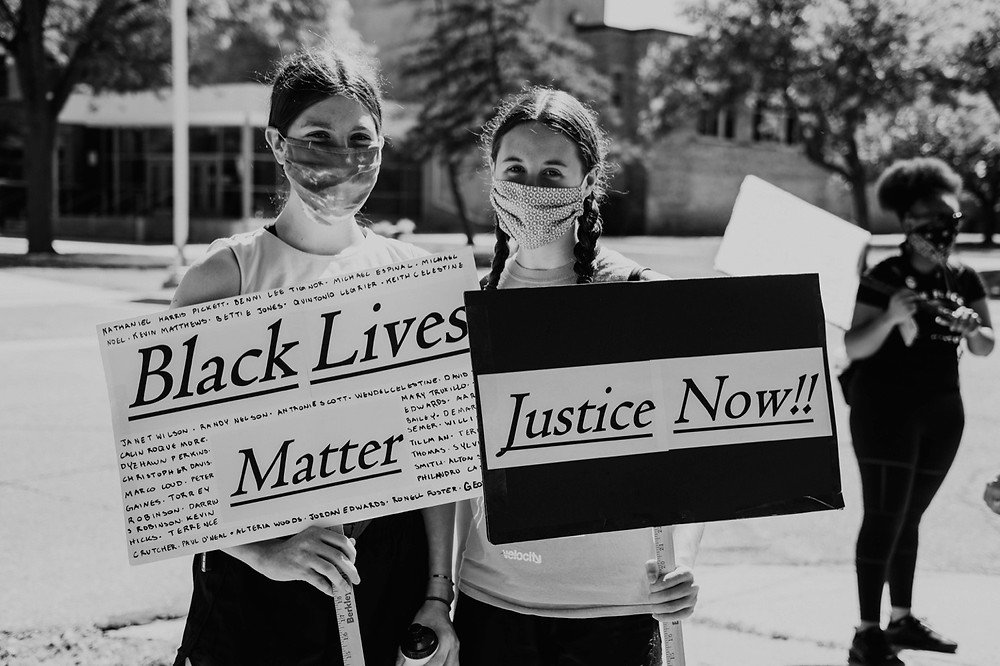 Black Lives Matters protestors in Berkley Michigan holding signs for justice