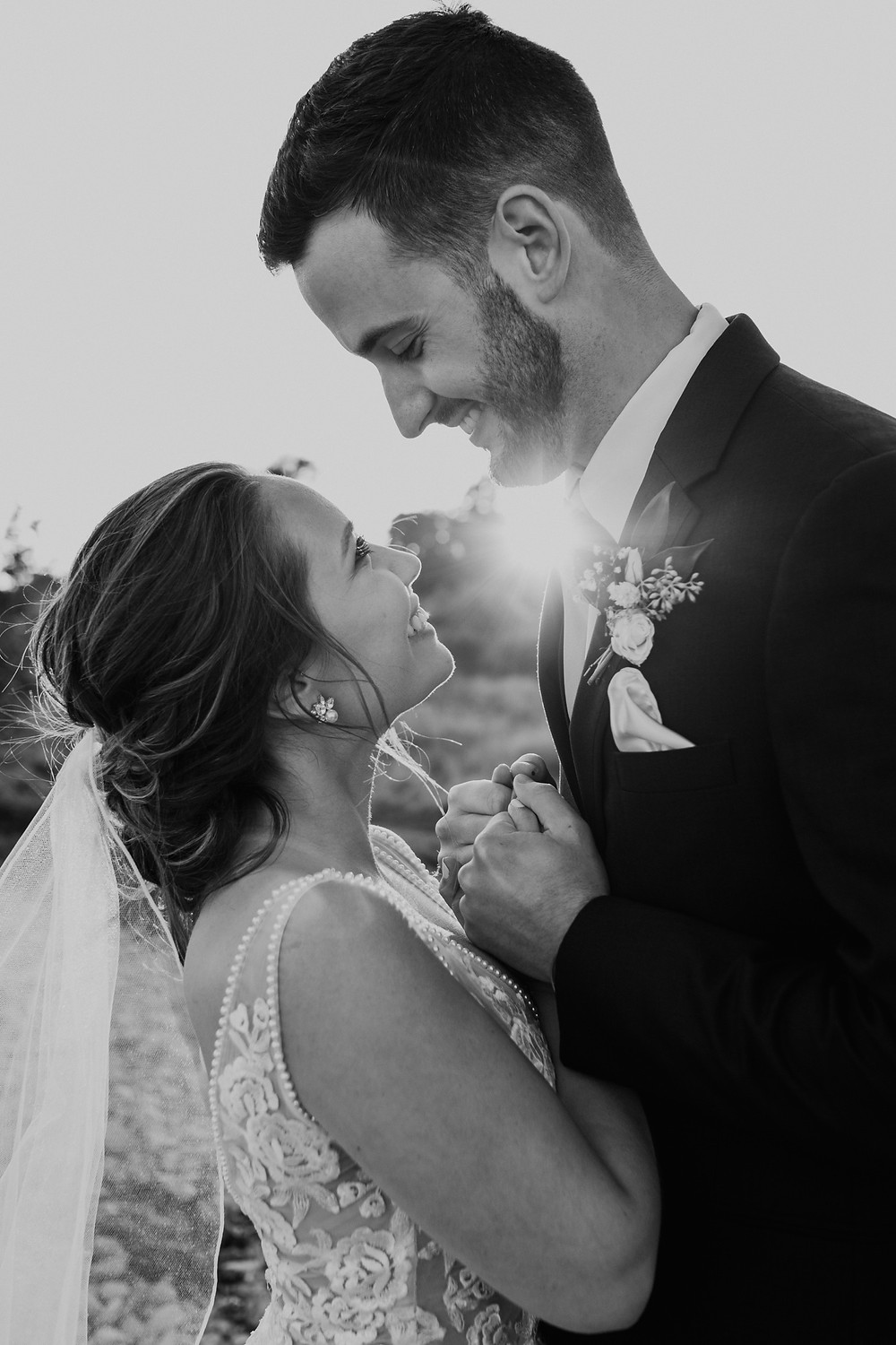 Black and white close up of bride and groom. Photographed by Nicole Leanne Photography.