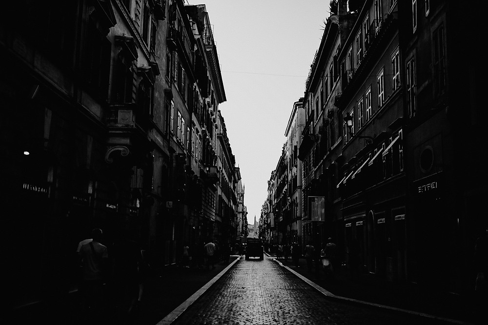 Black and white photo of Parisian street. Photographed by Nicole Leanne Photography.
