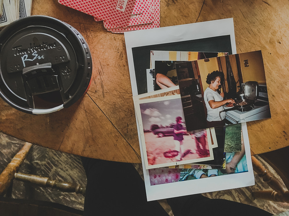 old photographs on a kitchen table