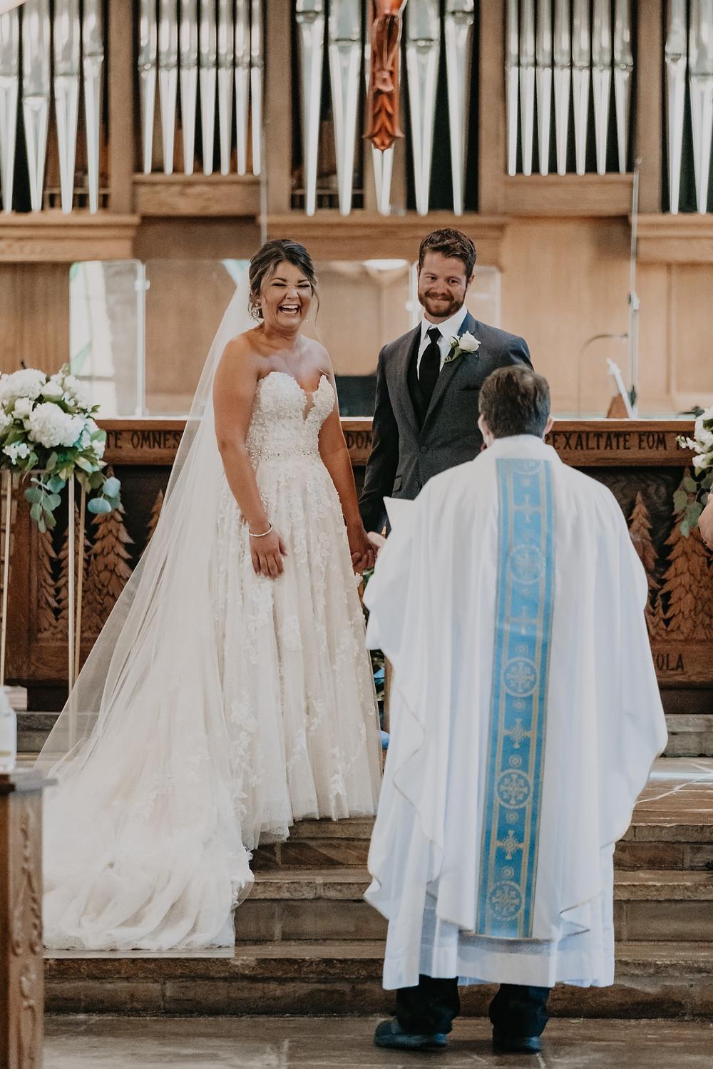 Catholic church wedding ceremony. Photographed by Nicole Leanne Photography.