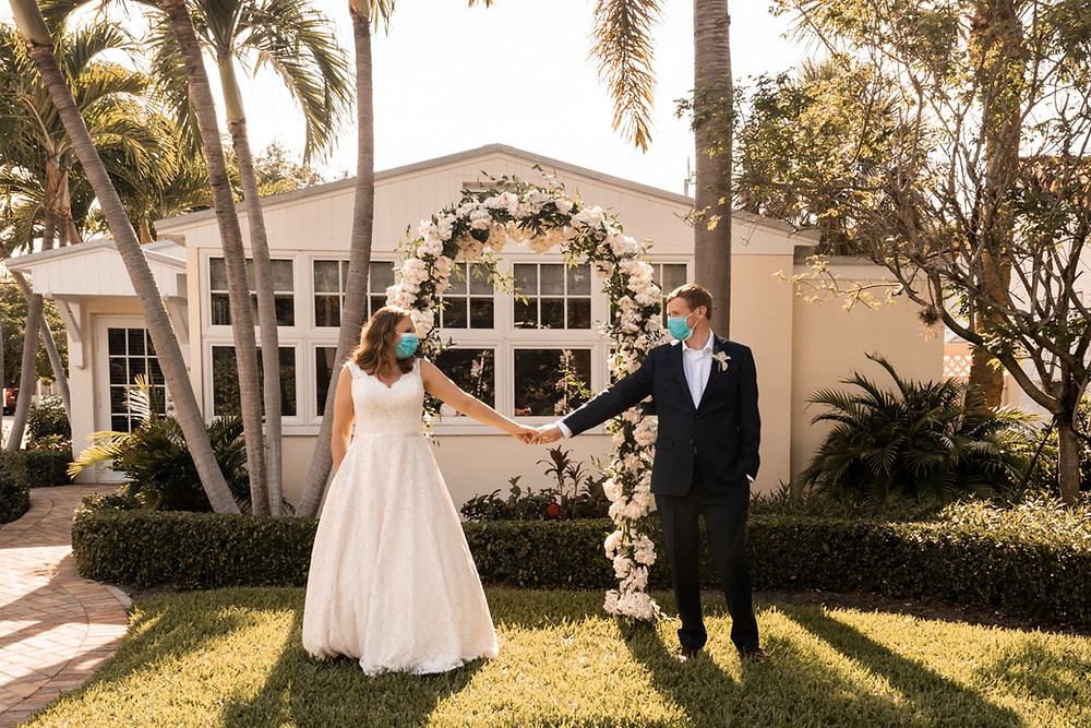 Covid bride and groom with masks at Florida wedding ceremony