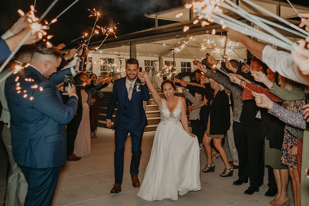 Sparkler exit at Mission Point Resort. Photographed by Nicole Leanne Photography.