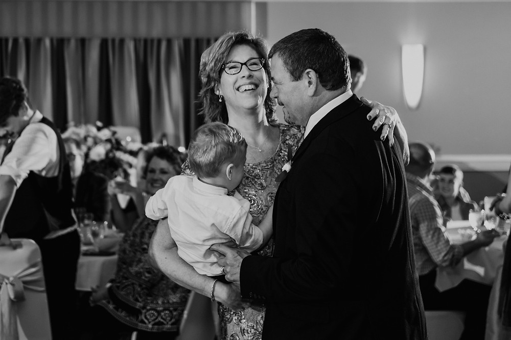 Dance floor candids at wedding. Photographed by Nicole Leanne Photography.
