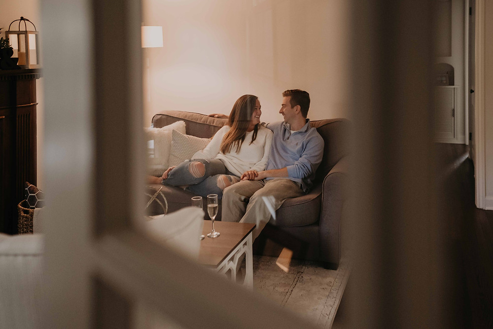 In home lifestyle photos with couple on couch. Photographed by Nicole Leanne Photography.