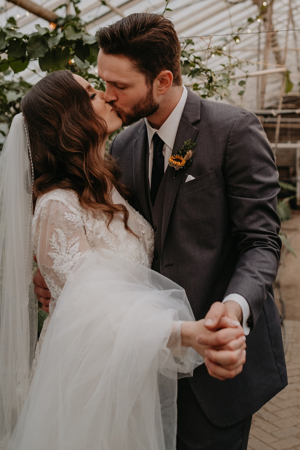 Bride and groom at Metro Detroit wedding. Photographed by Nicole Leanne Photography.