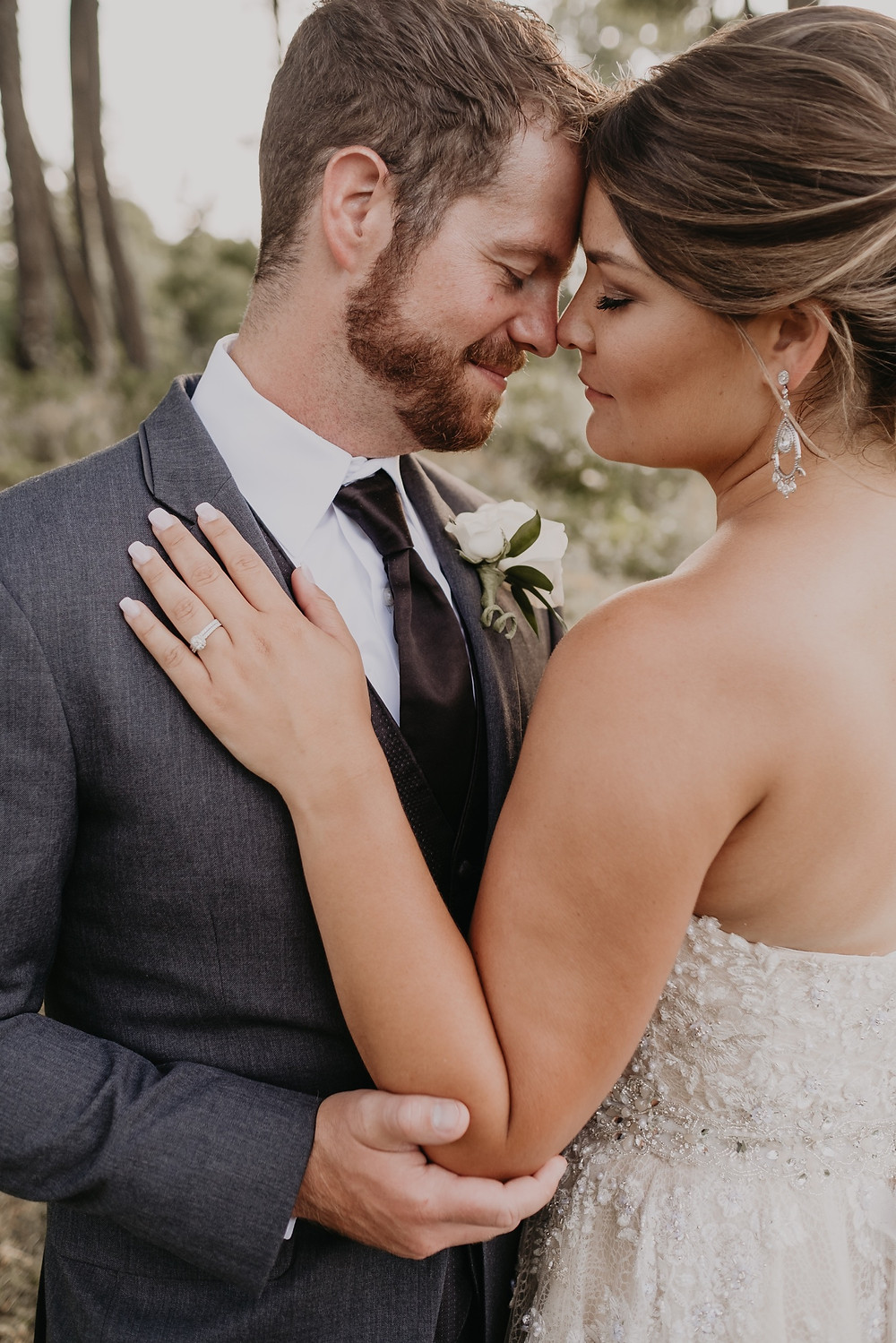 Bride and groom summer wedding in Metro Detroit. Photographed by Nicole Leanne Photography.