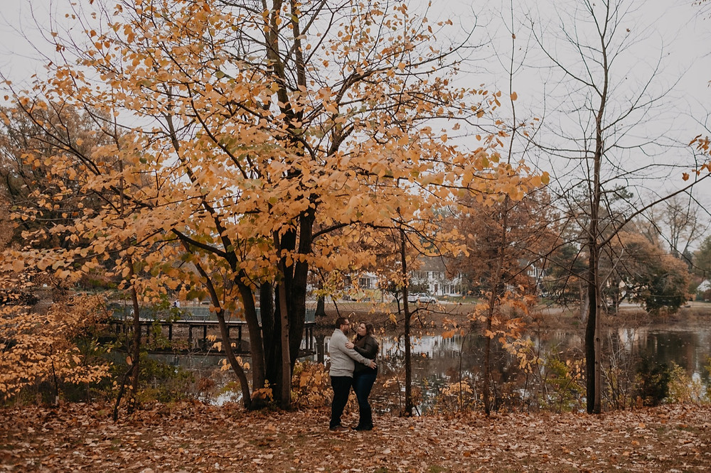 Fall engagement session at Metro Detroit park. Photographed by Nicole Leanne Photography.