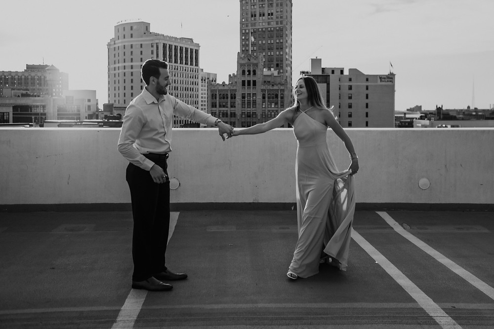 Couple dancing on Detroit rooftop. Photographed by Nicole Leanne Photography.