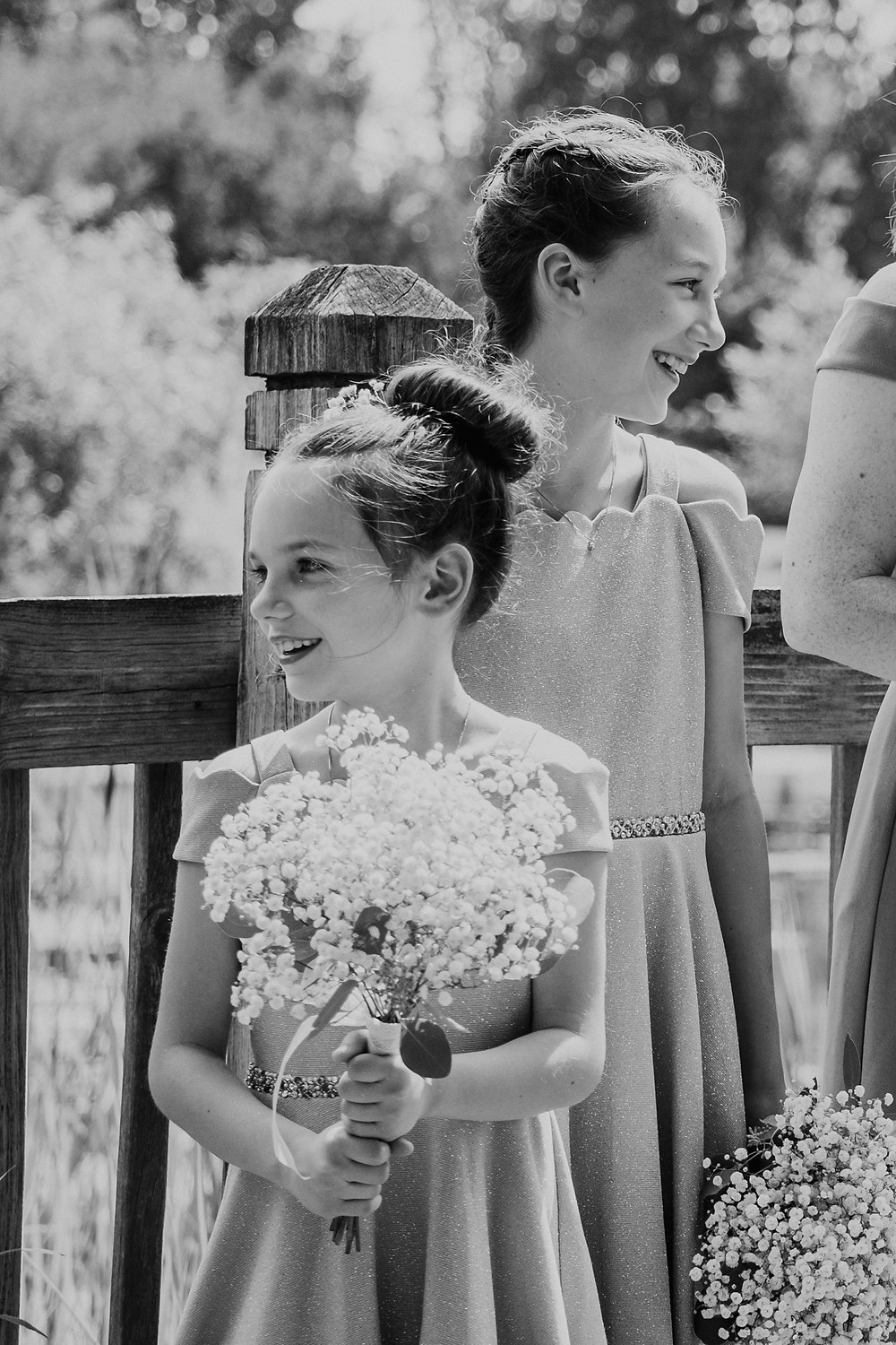 Black and white of junior bridesmaids in Metro Detroit wedding. Photographed by Nicole Leanne Photography.