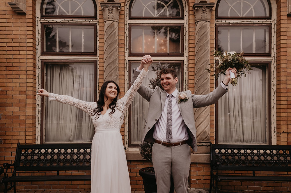 Detroit bride and groom celebrate wedding day holding hands and smiling. Photographed by Metro Detroit Wedding Photographer Nicole Leanne Photography