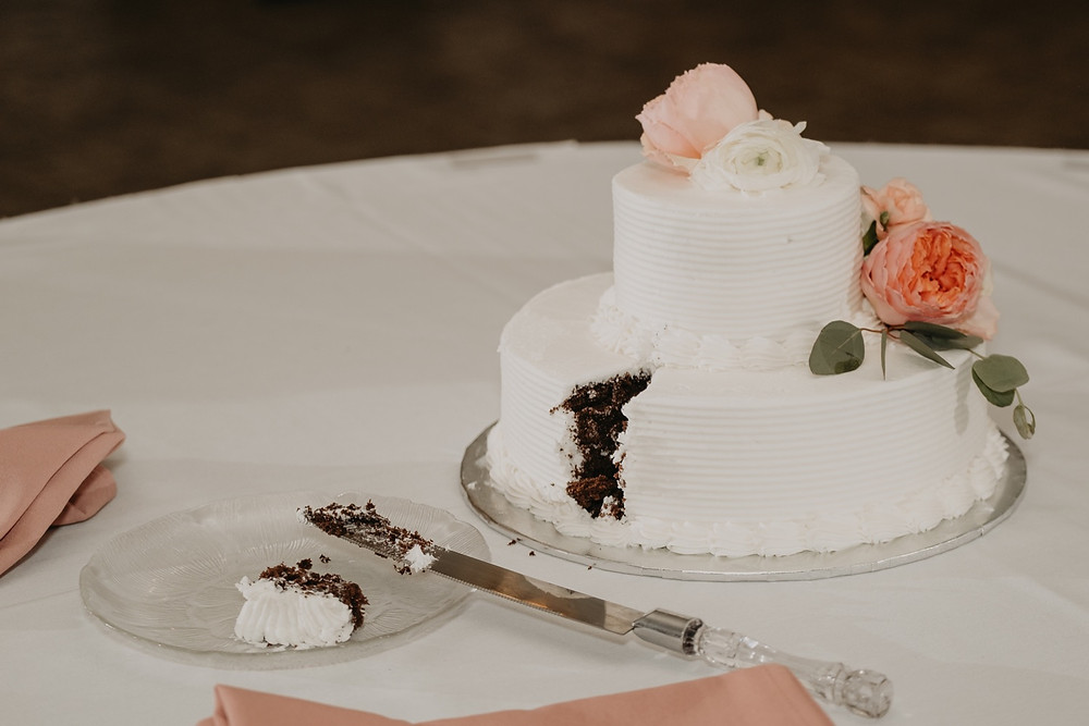 Wedding cake cutting. Photographed by Nicole Leanne Photography.