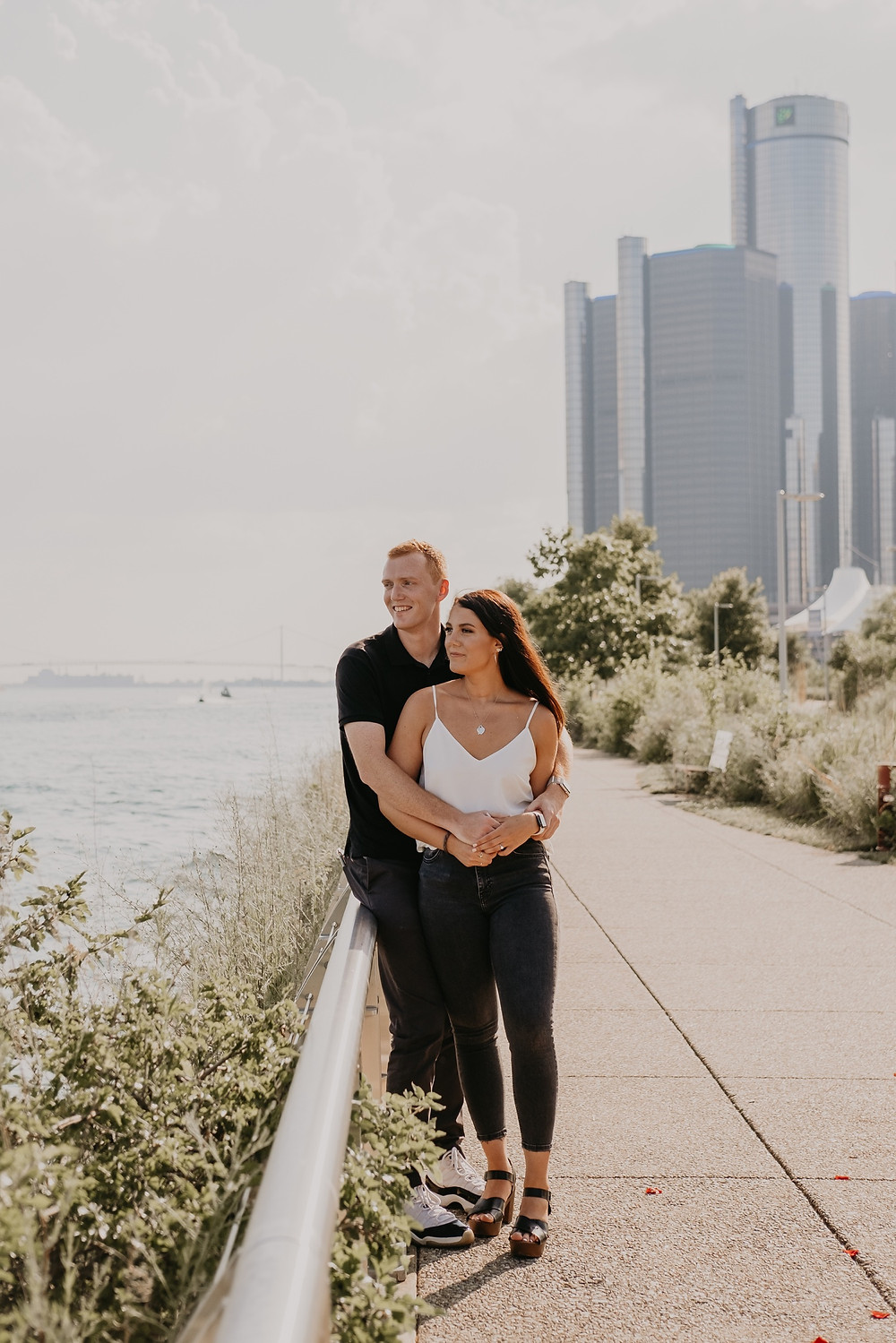 Detroit Riverwalk engagement in Downtown Detroit. Photographed by Nicole Leanne Photography