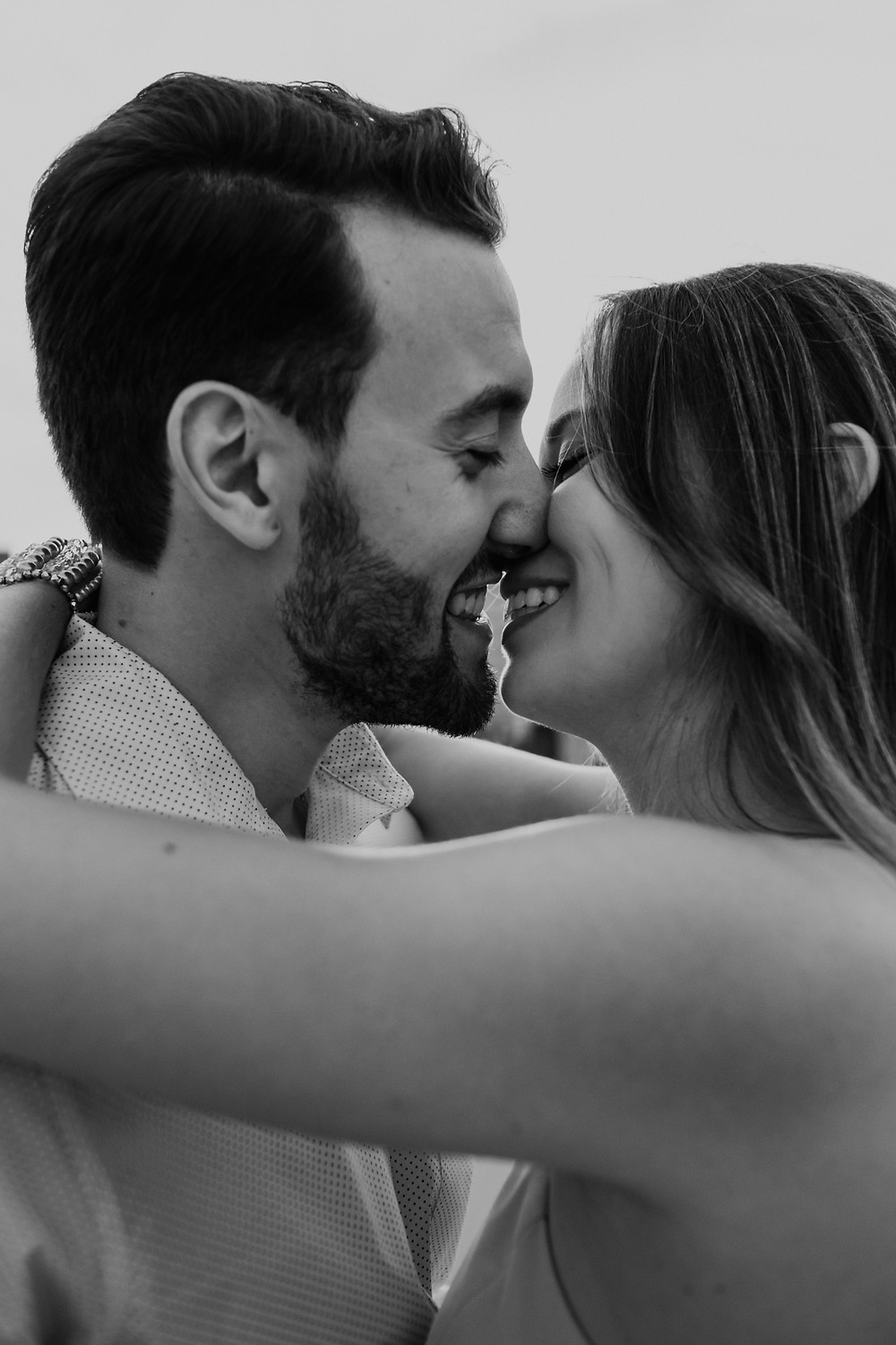 Couple kissing for engagement photos. Photographed by Nicole Leanne Photography.