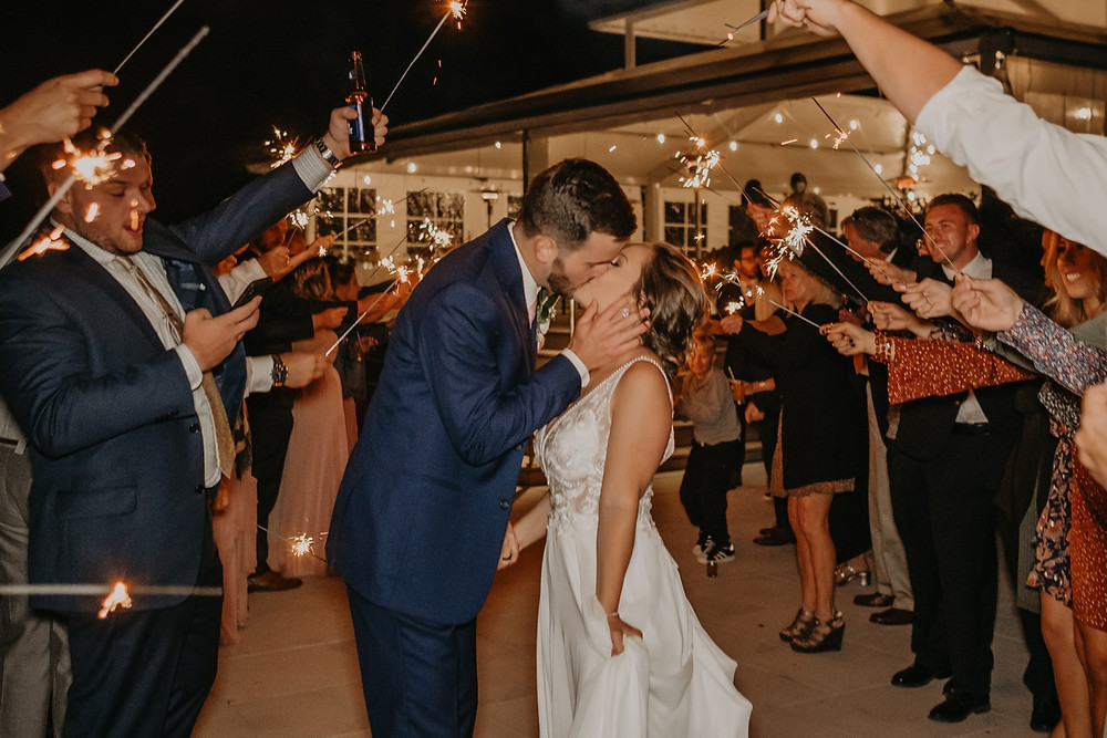 Sparkler exit in Northern Michigan wedding. Photographed by Nicole Leanne Photography.