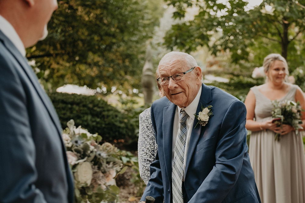 Family members greeting the groom after the wedding ceremony. Photographed by Nicole Leanne Photography.
