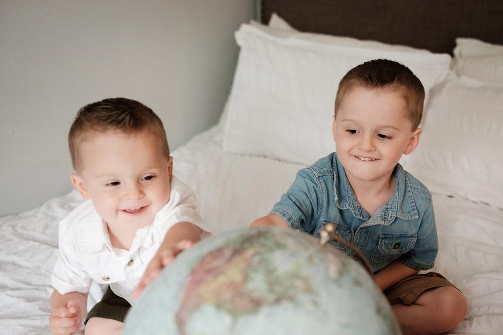 boys spinning a globe