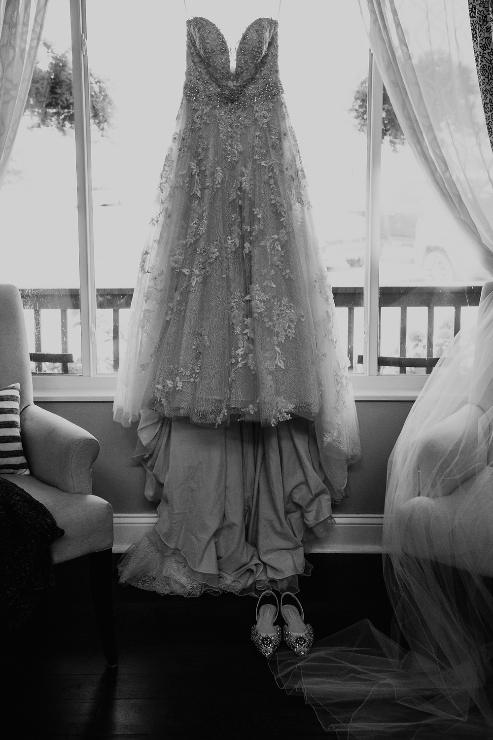 Wedding dress in window. Photographed by Nicole Leanne Photography.