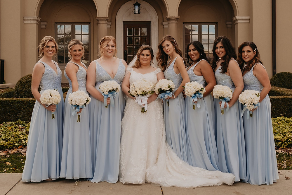 Bridesmaids and bride on wedding day. Photographed by Nicole Leanne Photography.