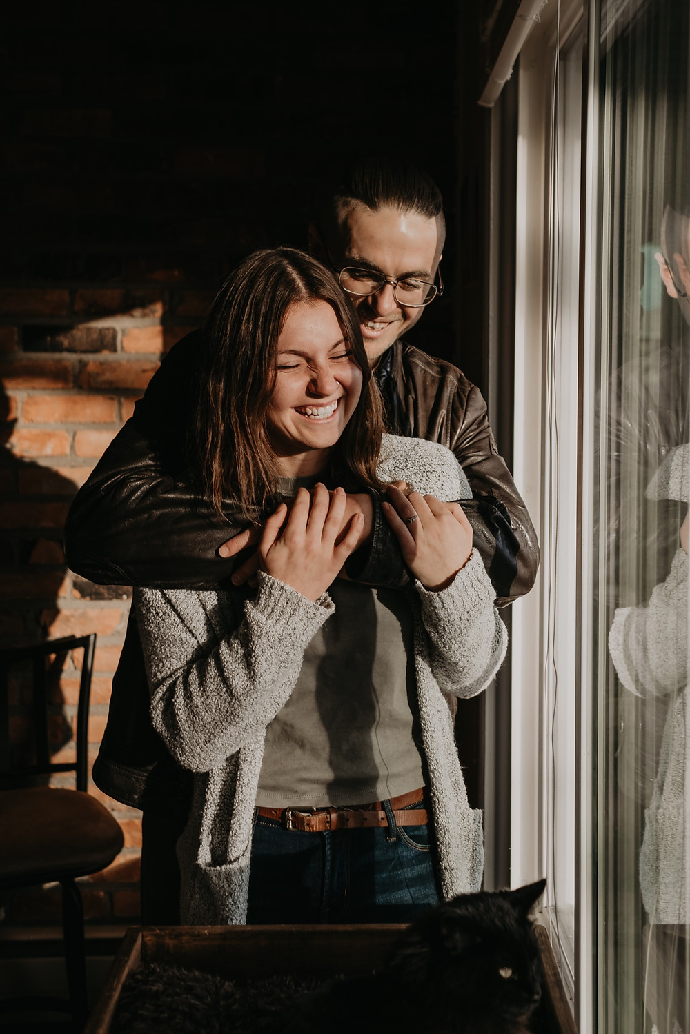 Couple laughing during engagement photos. Photographed by Nicole Leanne Photography.