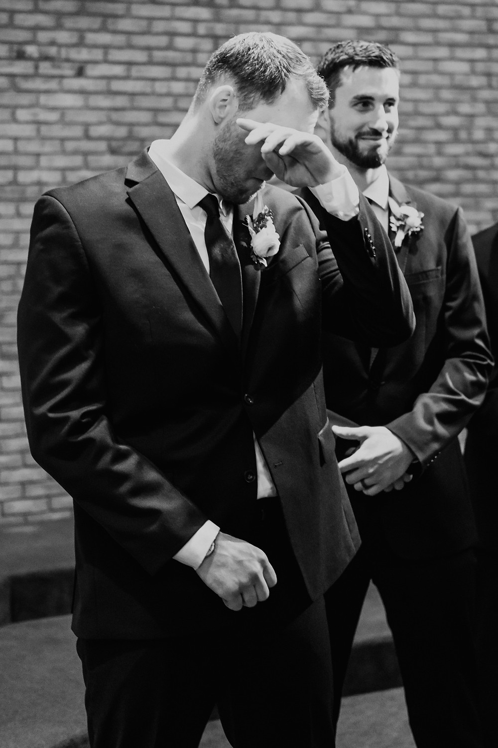 Groom tearing up during wedding ceremony. Photographed by Nicole Leanne Photography.