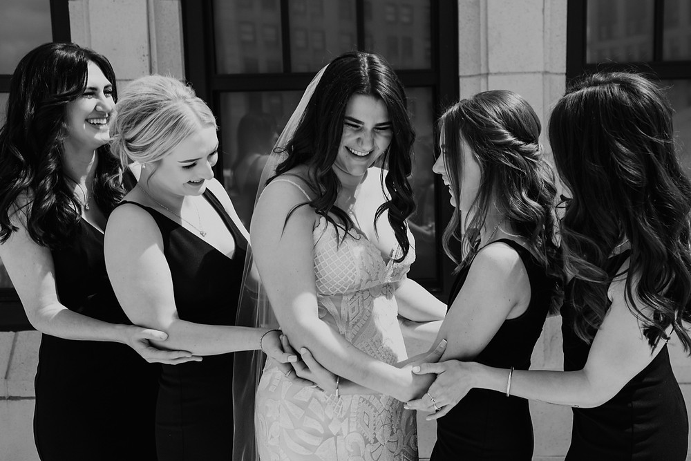 Bride and bridesmaids before Metro Detroit wedding ceremony. Photographed by Nicole Leanne Photography.