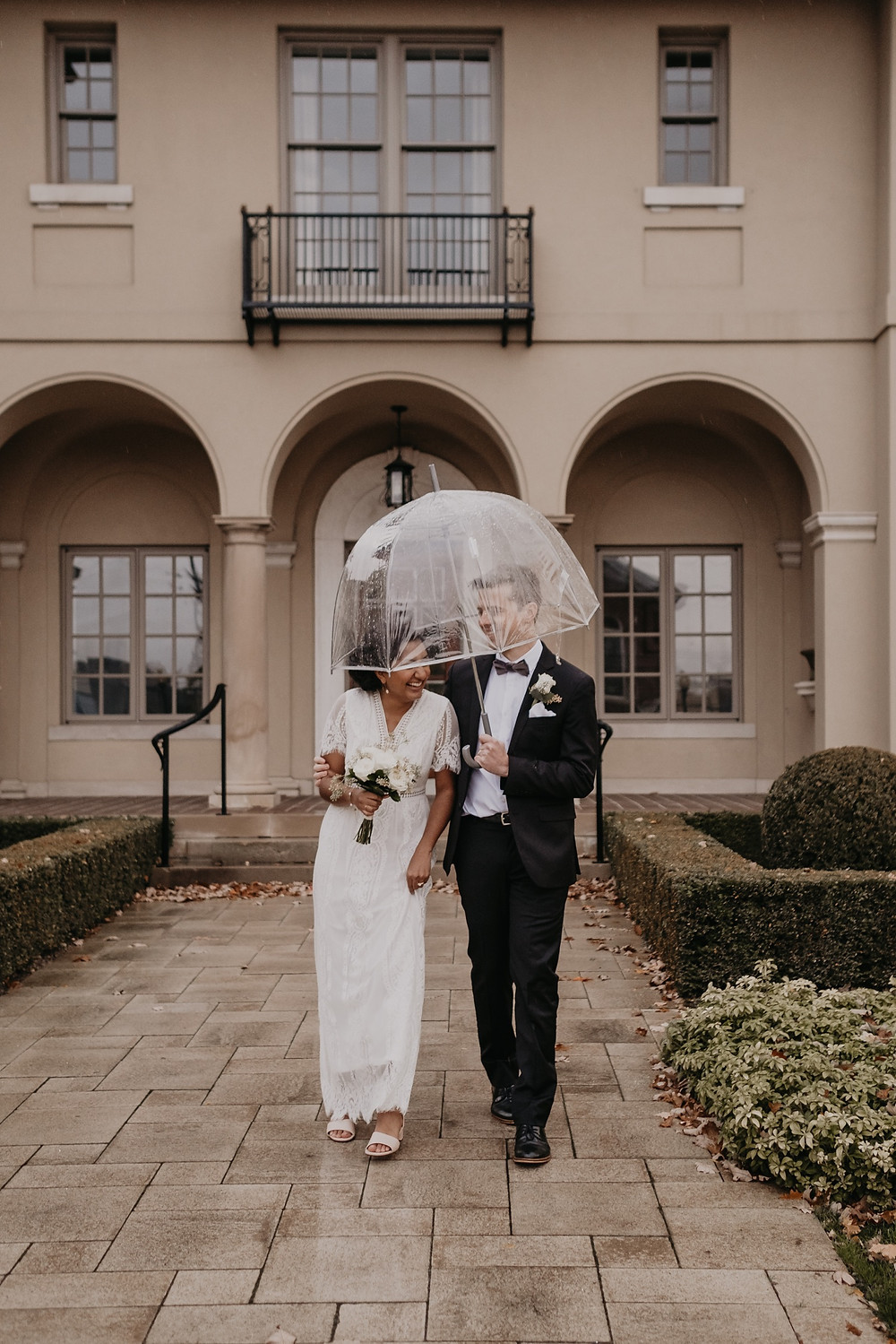 Rainy wedding day in Metro Detroit. Photographed by Nicole Leanne Photography.