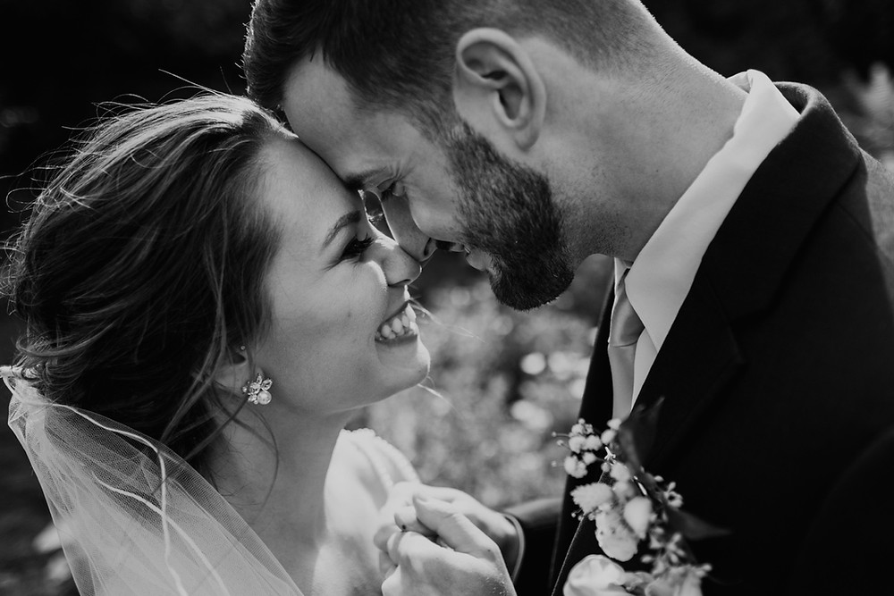 Close up of bride and groom on wedding day. Photographed by Nicole Leanne Photography.