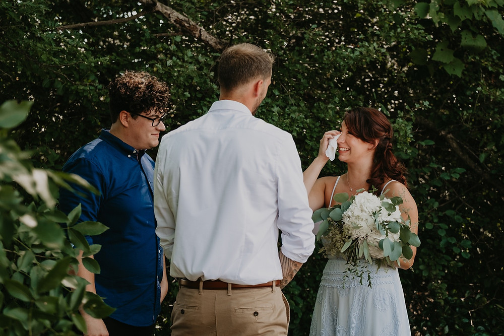 Bride crying at intimate park wedding ceremony. Photographed by Nicole Leanne Photography.