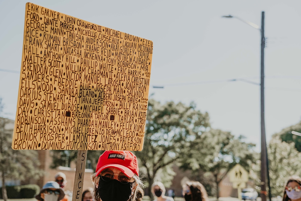 Protest sign with names of black victims of racial violence at Berkley Michigan protest