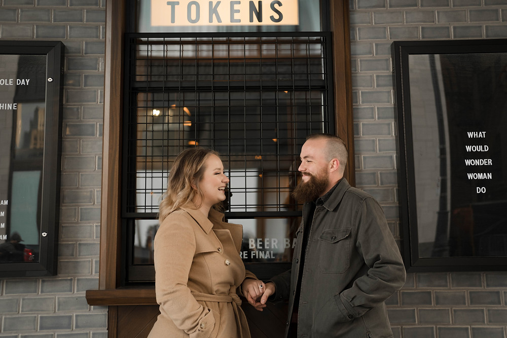 Couple outside of The Brakeman in Detroit Michigan. Photography by Nicole Leanne Photography