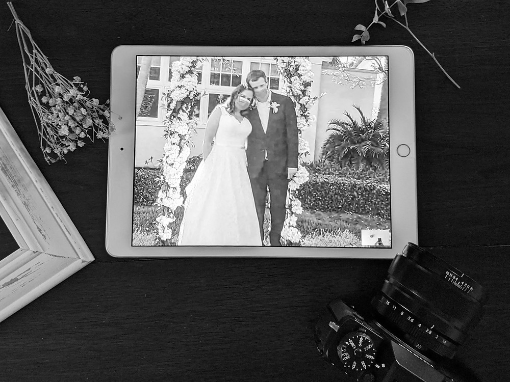 iPad showing couple on wedding day with masks during 2020 Coronavirus pandemic. Photography by Nicole Leanne Photography