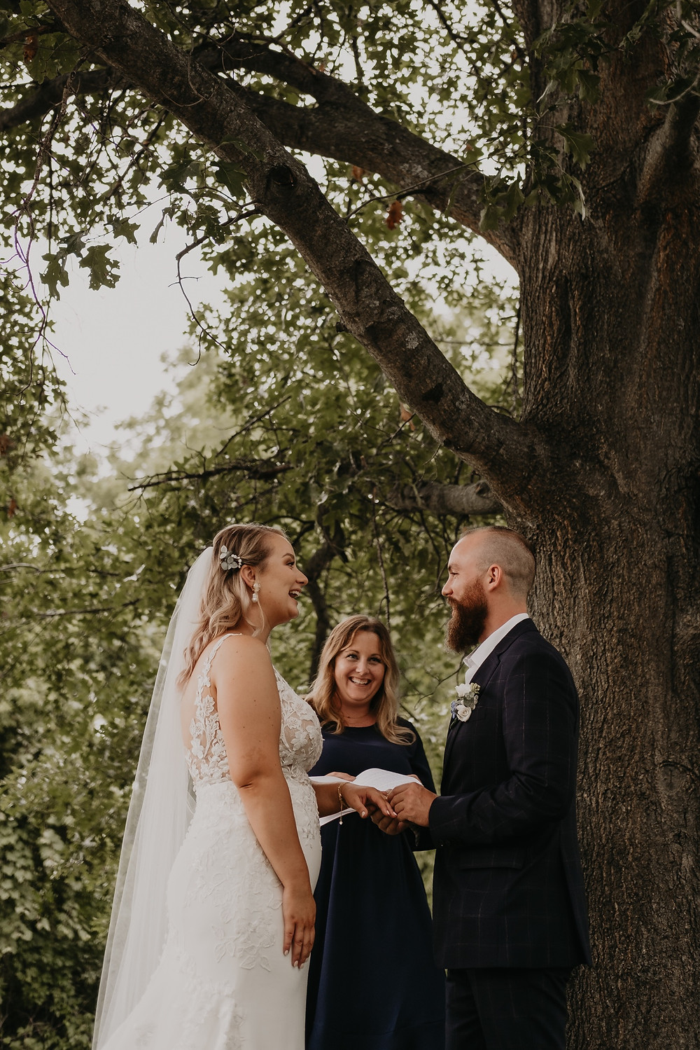 Metro Detroit wedding ceremony under a tree. Photographed by Nicole Leanne Photography.
