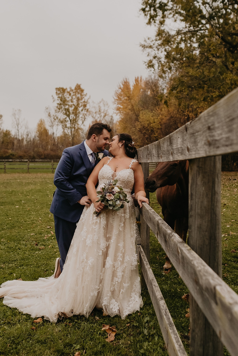 Michigan bride and groom wedding photos at barn with horse