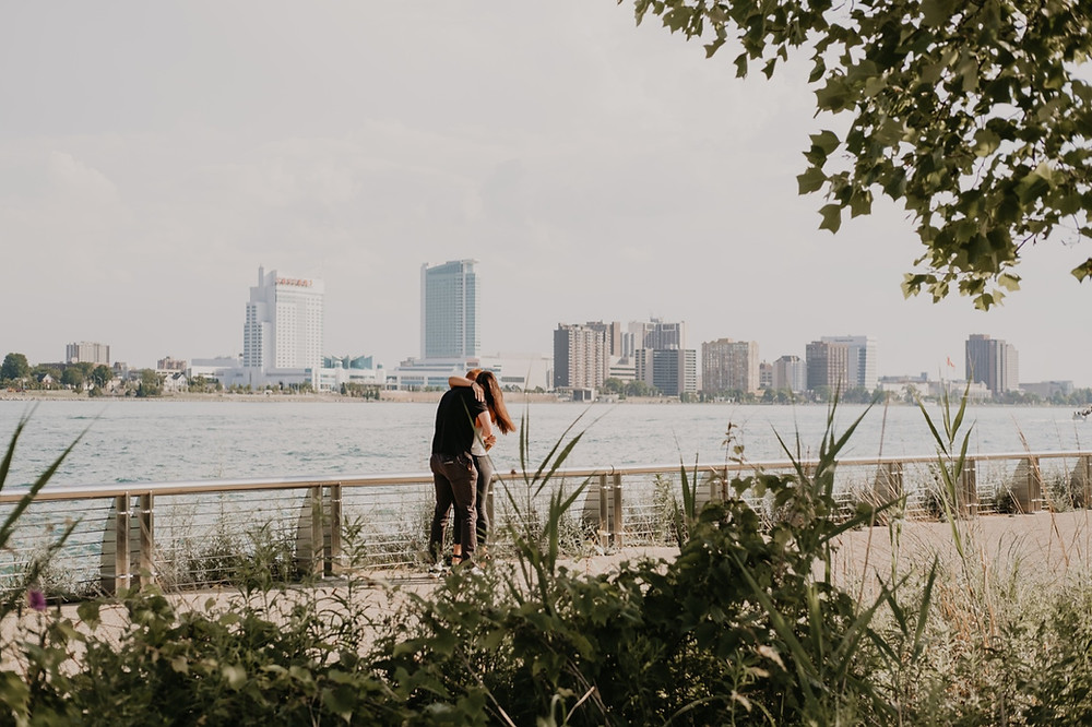 Canada skyline in background with Detroit proposal. Photographed by Nicole Leanne Photography