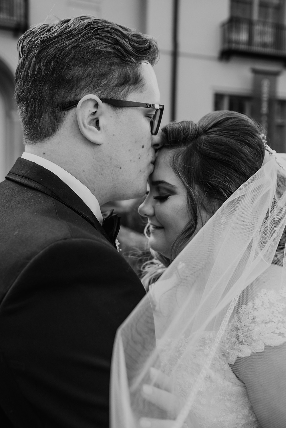 Black and white photo of bride and groom at Metro Detroit wedding. Photographed by Nicole Leanne Photography.