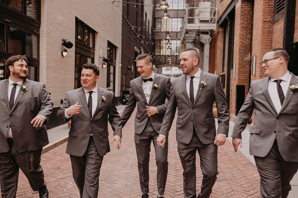 Groomsmen in Shinola Alley in Detroit. Photographed by Nicole Leanne Photography.
