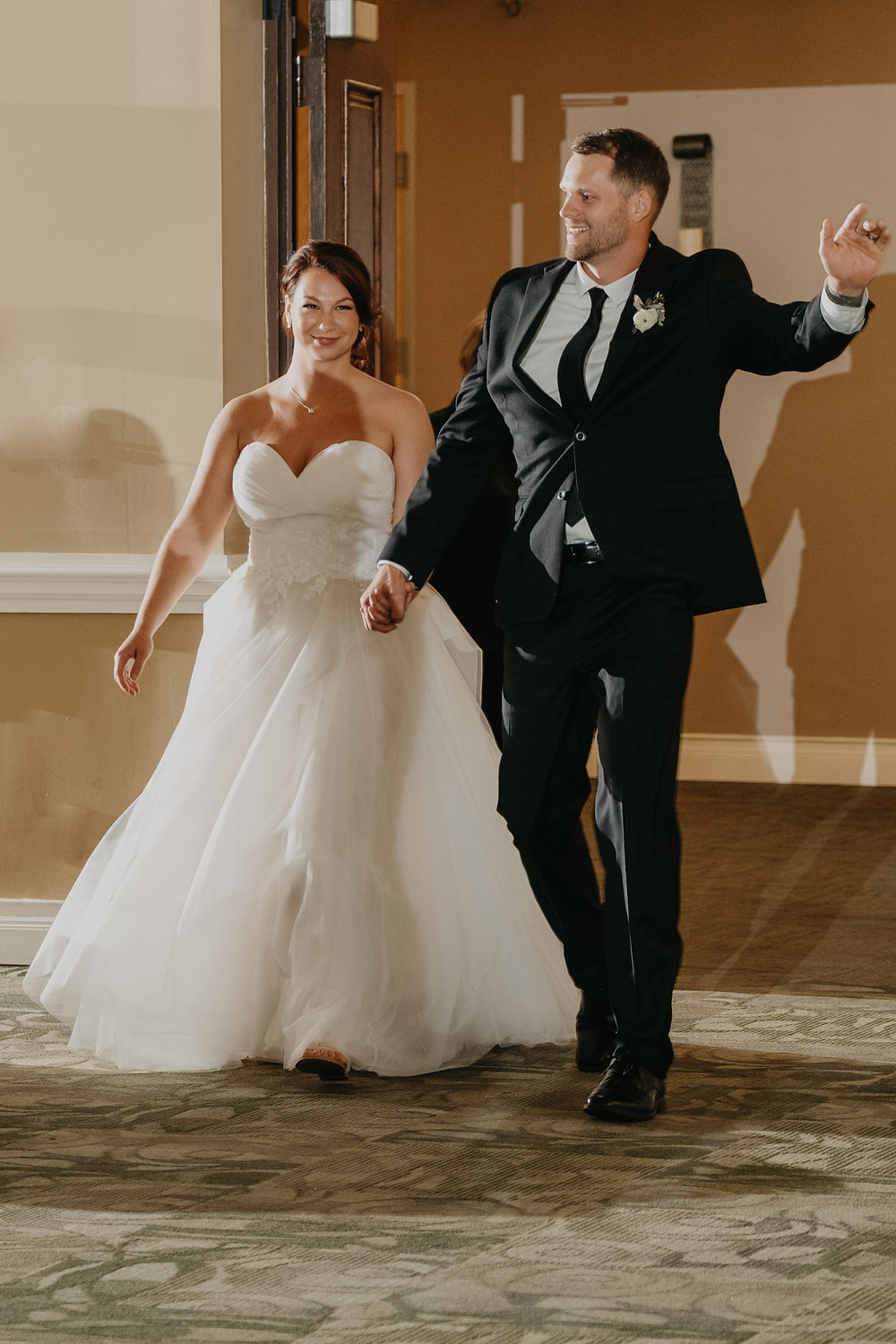 Bride and groom arriving to reception. Photographed by Nicole Leanne Photography.