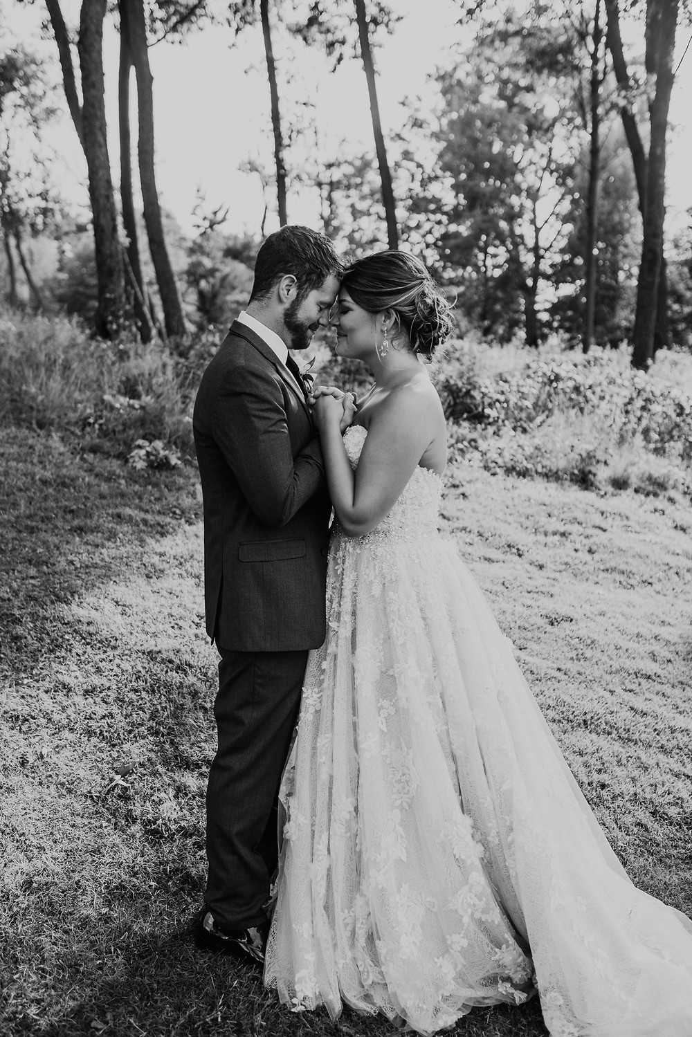 Black and white wedding photos in Metro Detroit. Photographed by Nicole Leanne Photography.