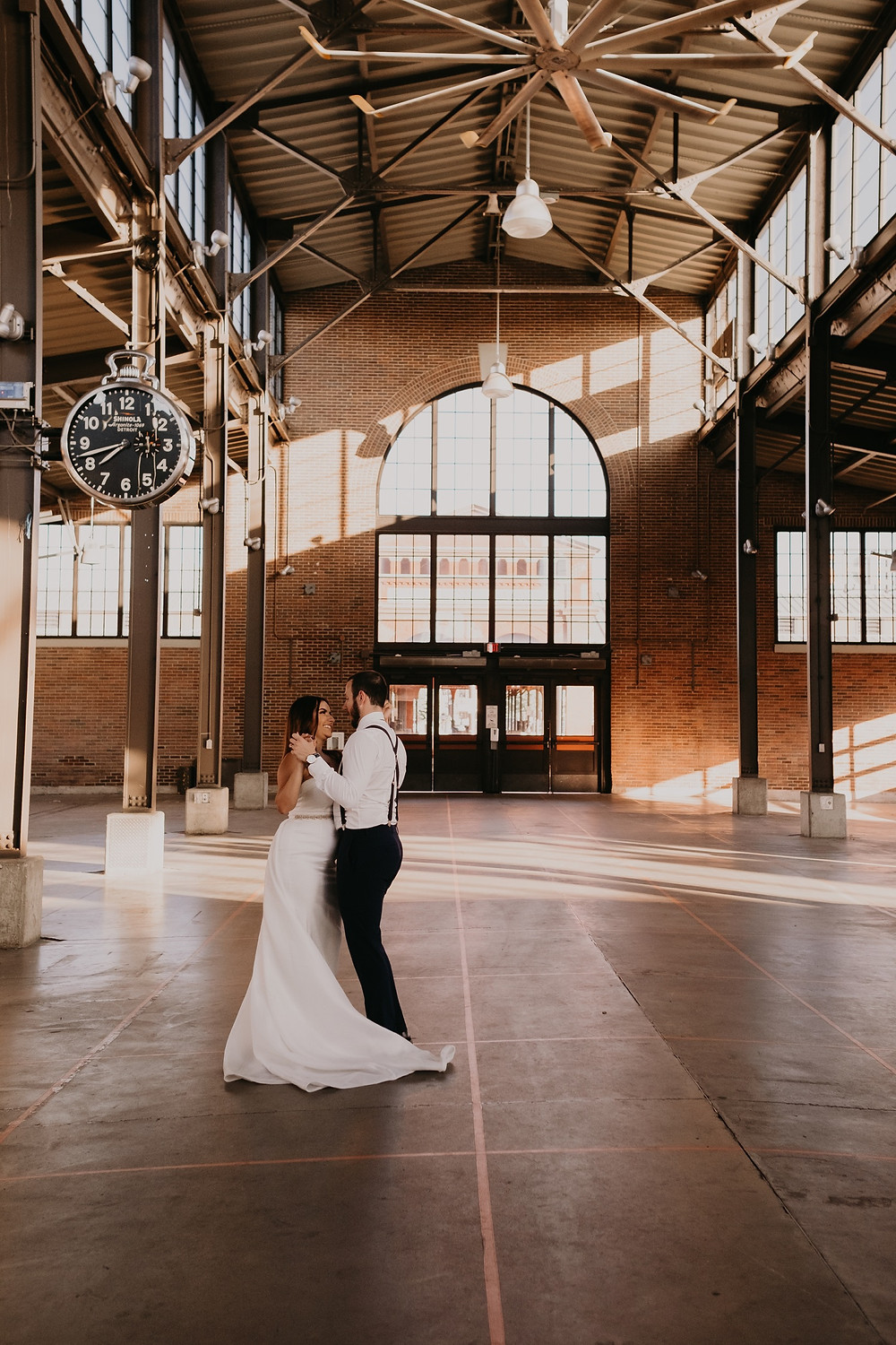 Bride and groom dancing at Eastern Market. Photographed by Nicole Leanne Photography.