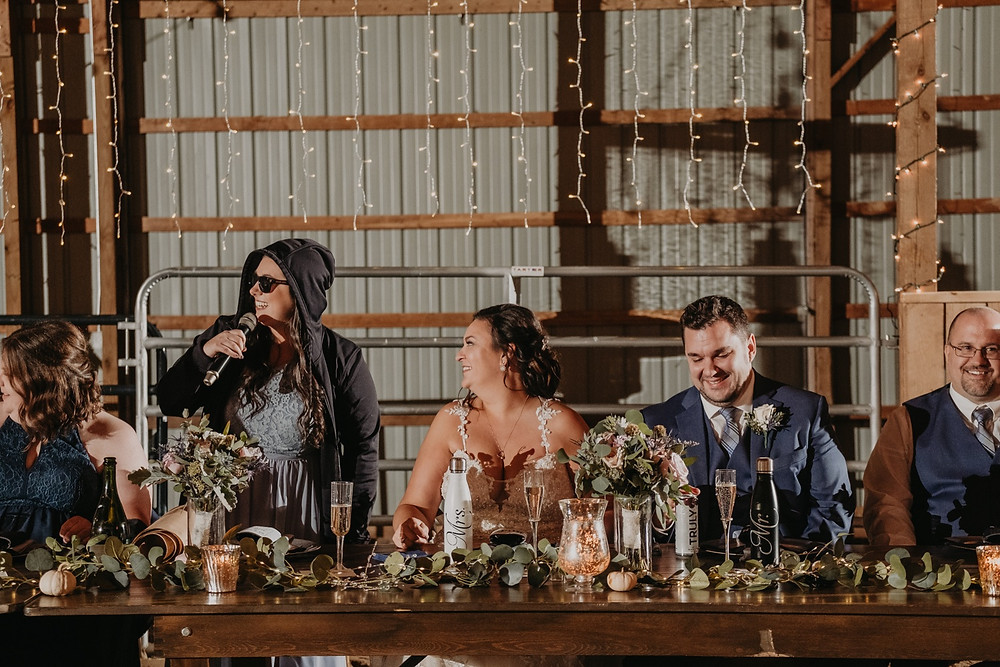 Maid of honor speech at rustic barn wedding. Photographed by Nicole Leanne Photography.