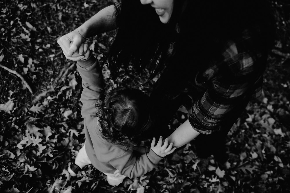 mother plays with son, black and white