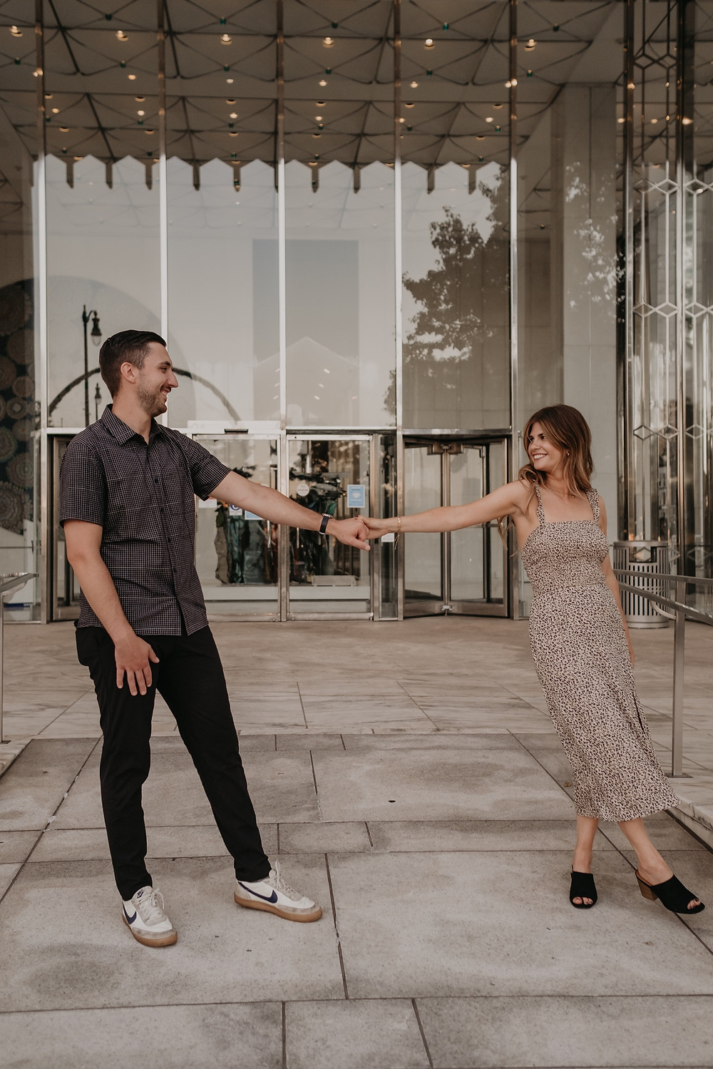 Couple dancing in Detroit for engagement photos. Photographed by Nicole Leanne Photography.
