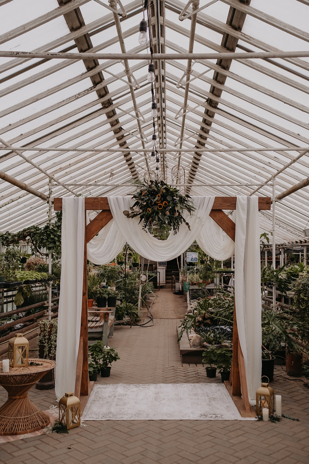 Wooden wedding ceremony structure by The Lost Forty. Photographed by Nicole Leanne Photography.