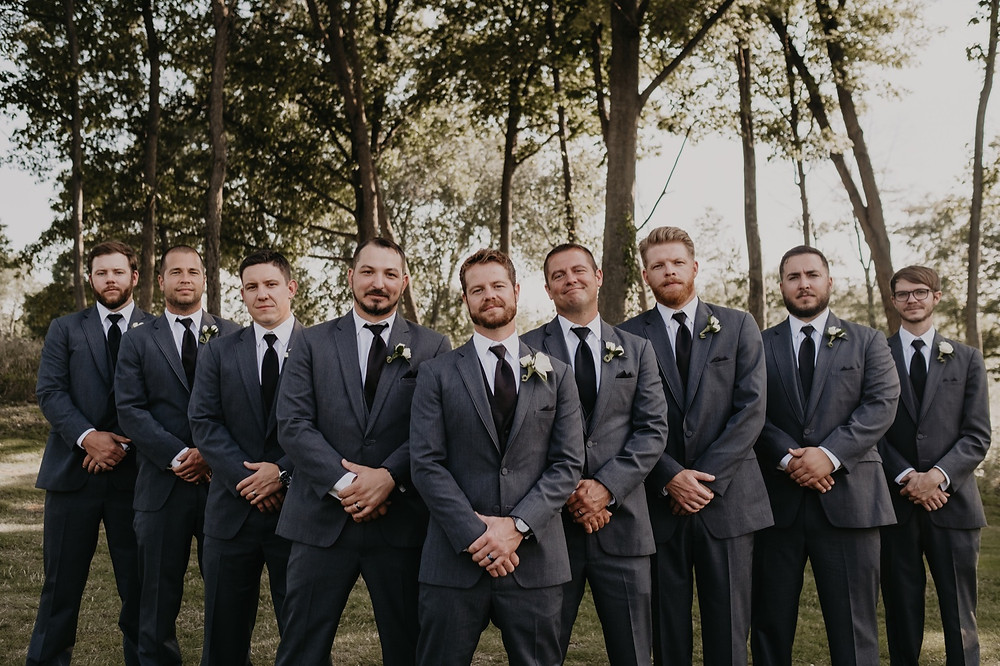 Groom and groomsmen after wedding ceremony. Photographed by Nicole Leanne Photography.