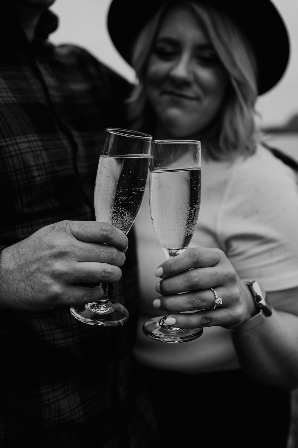 Champagne toast in black and white. Photographed by Nicole Leanne Photography.